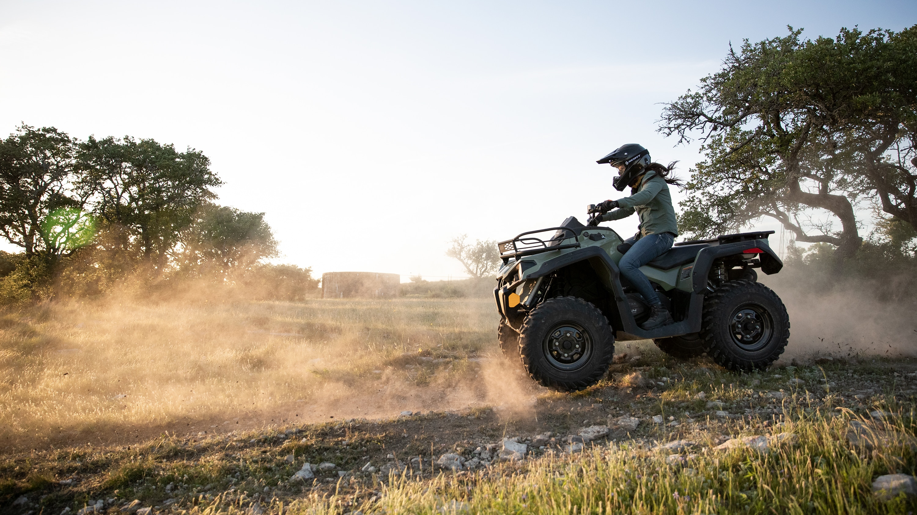 Woman riding a Can-Am Outlander DPS 570 ATV