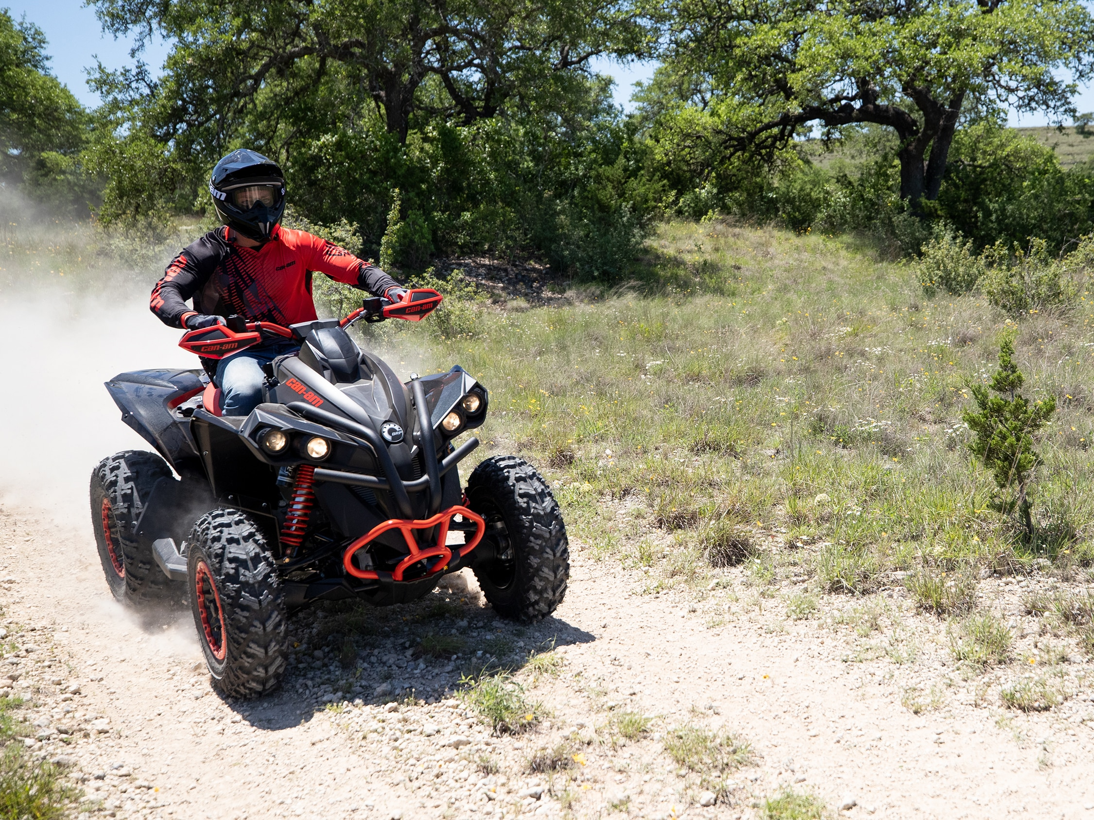 Man riding a Can-Am Renegade X xc ATV in a trail