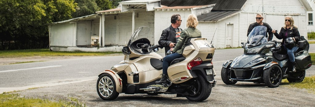 Two Couples Having A Chat Near An Old House On Their Can Am Spyder Vehicles