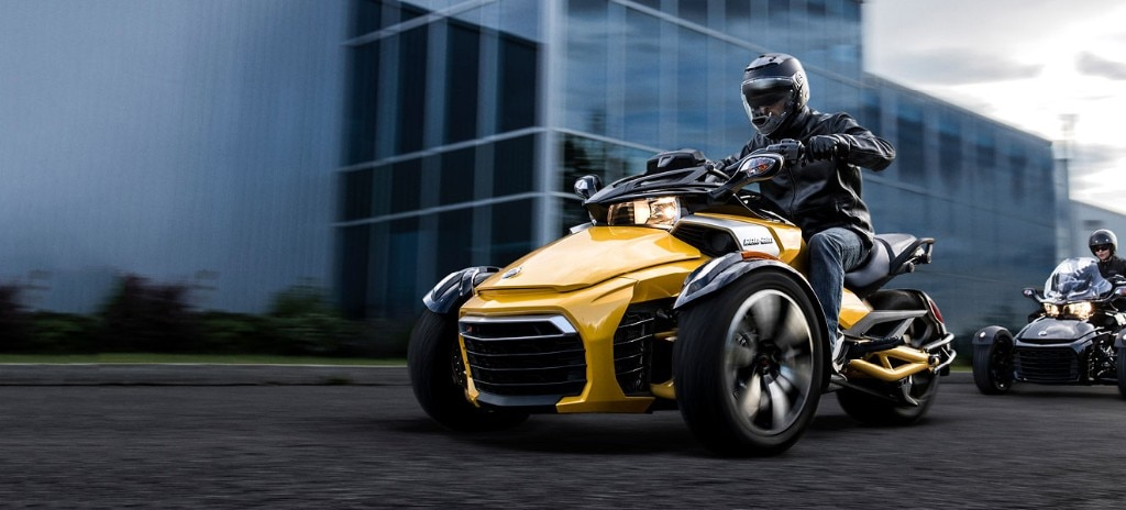 Two Persons Riding A Can Am Spyder F3 S Yellow In Town