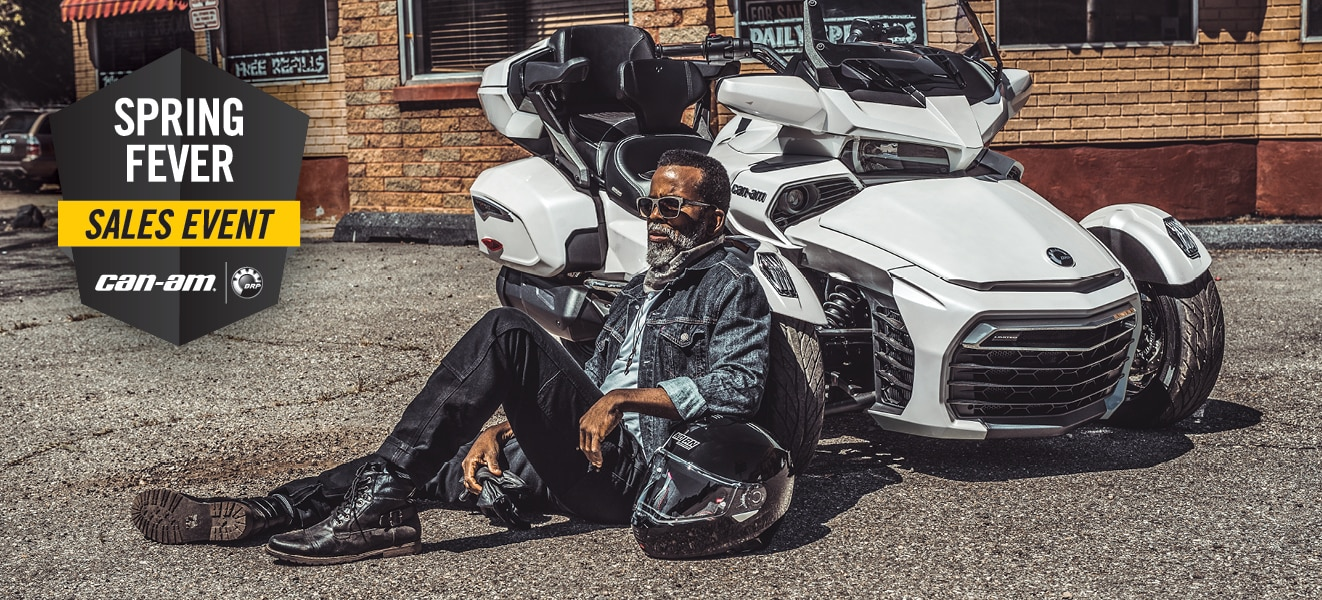 Two men riding Can-Am Spyder and promotion details