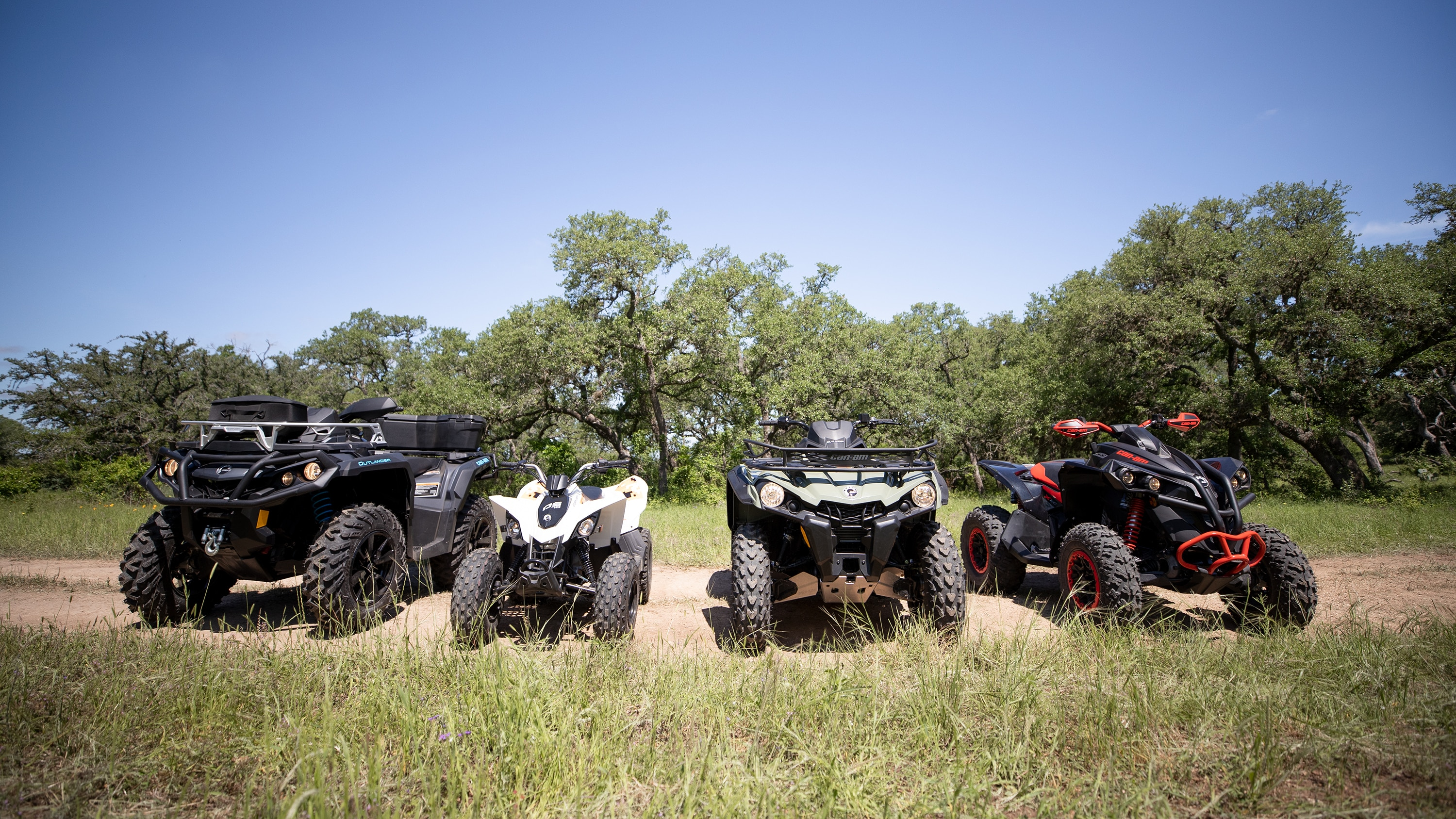 Four different models of Can-Am ATVs