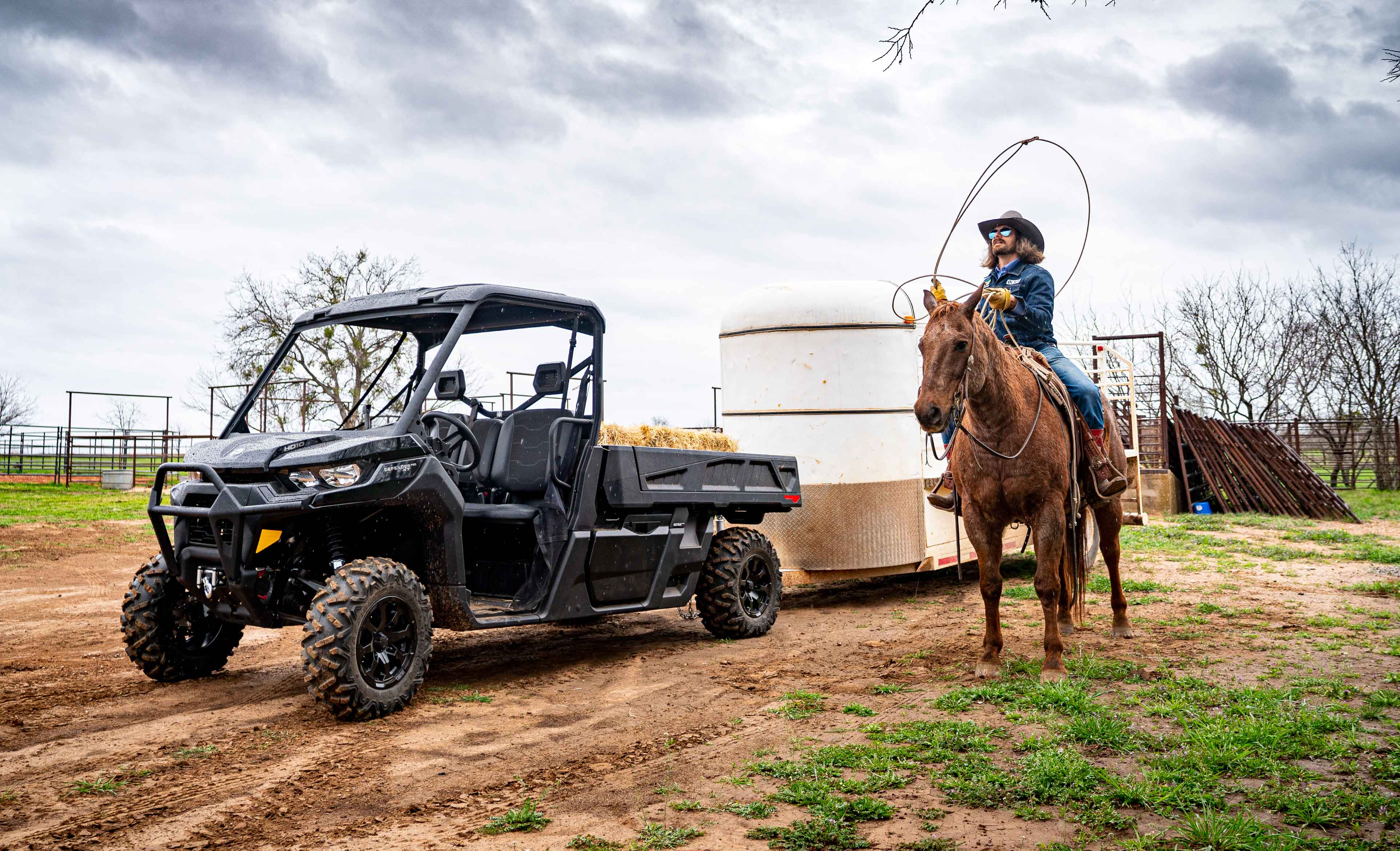 Can-Am Defender side-by-side vehicle ranching towing trailer livestock