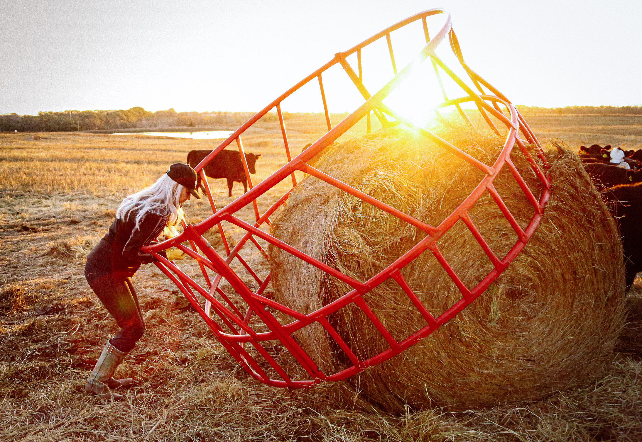 A woman working with a hay bale