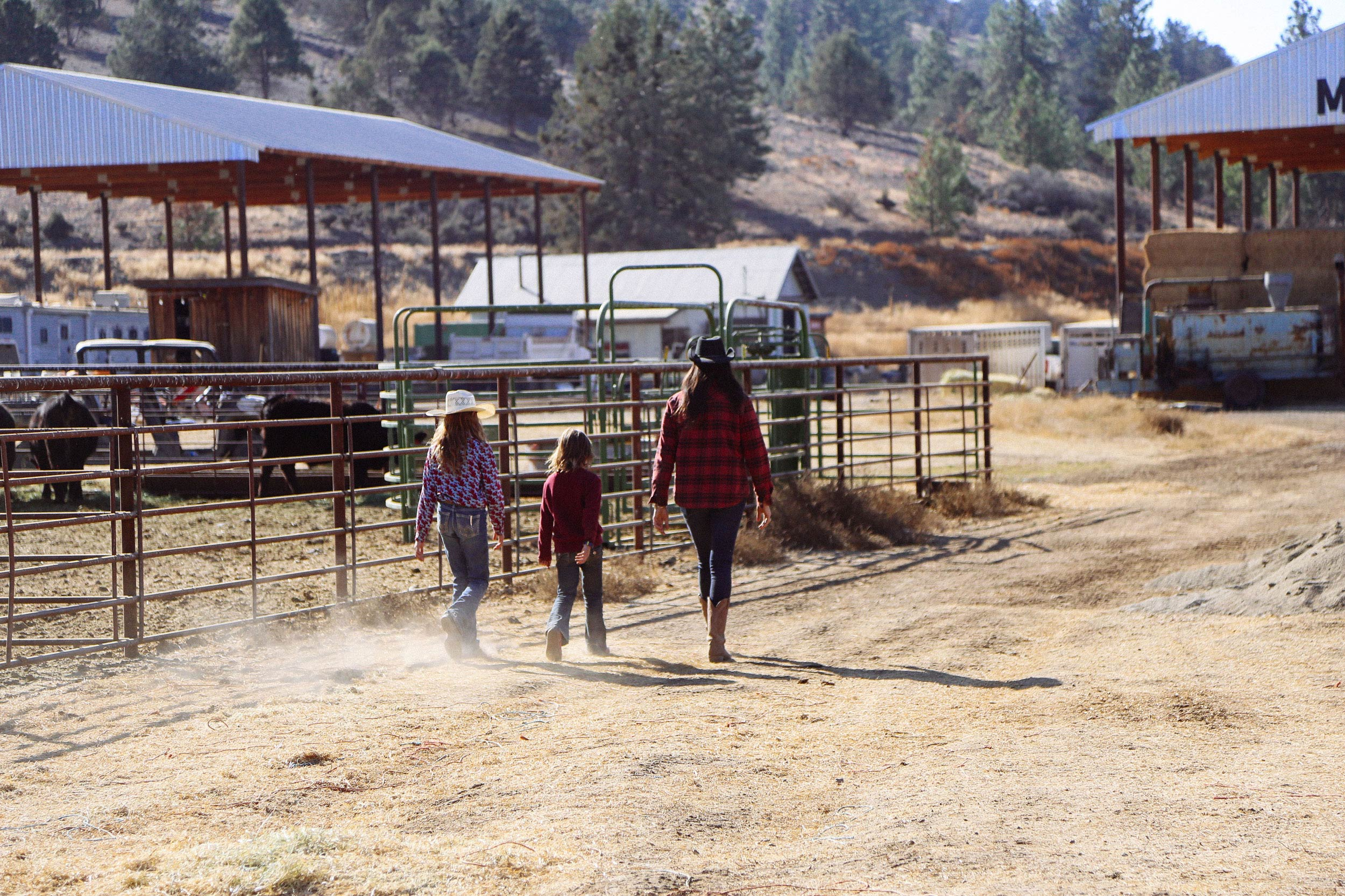 Mary Heffernan and two of her daughters walking on the ranch