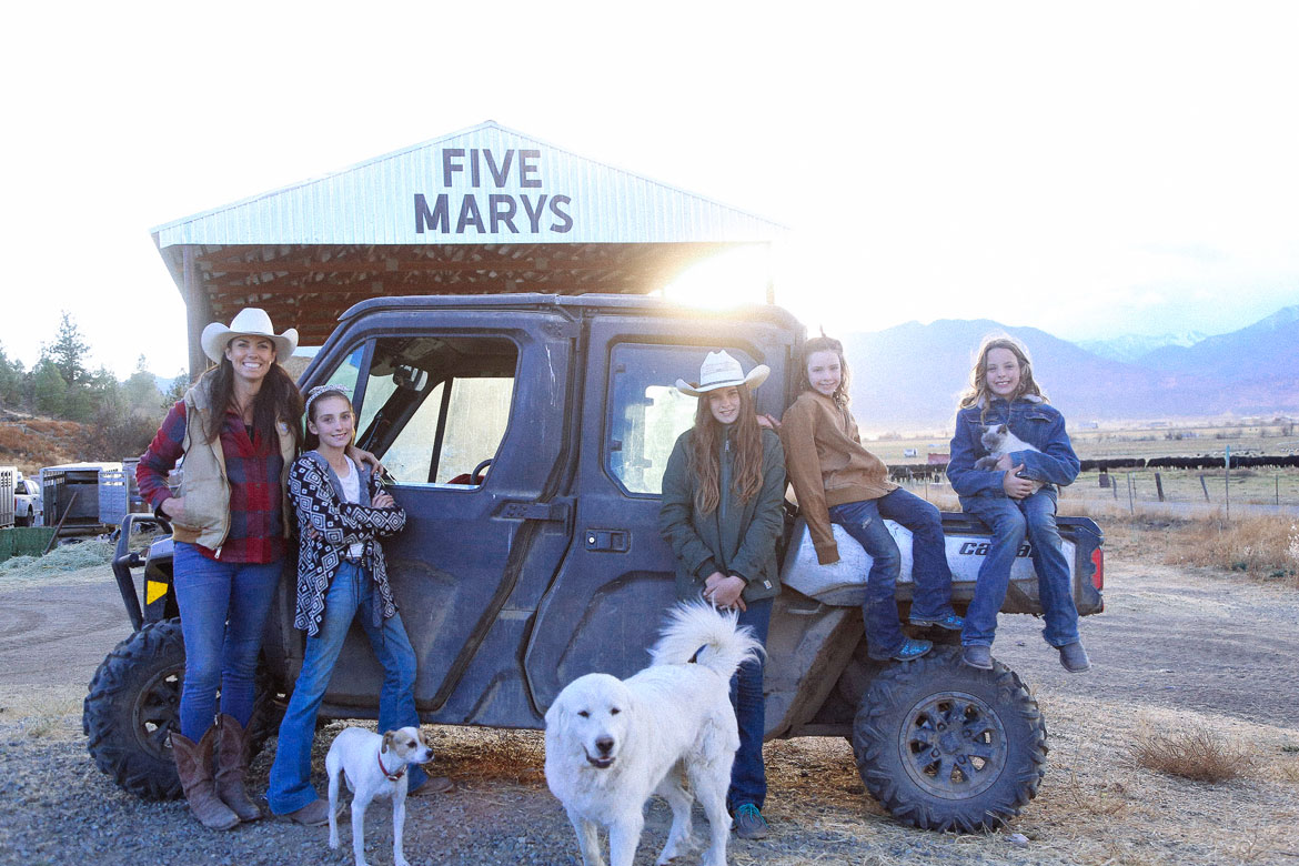 Mary Heffernan and her four girls and a Can-Am Defender in front of 5 Marys Farm