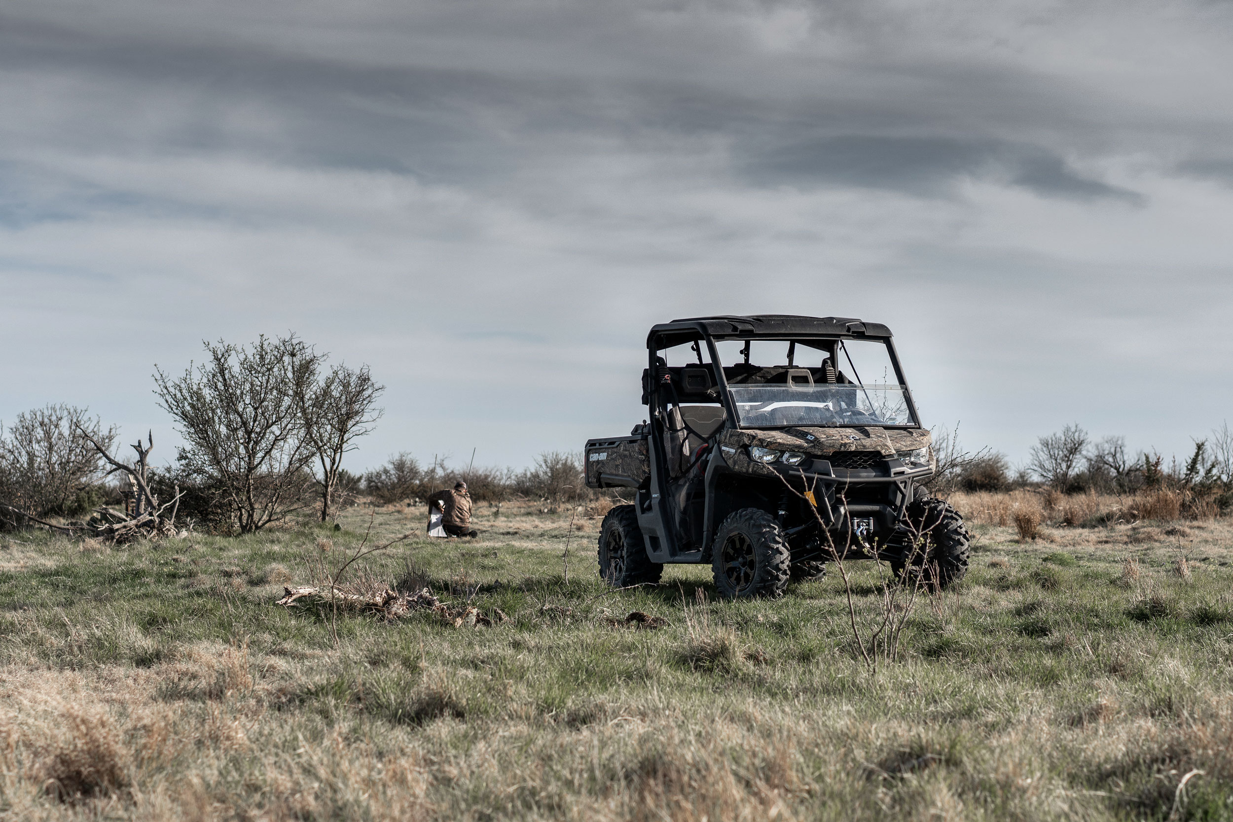 Can-Am Defender side-by-side and a man hunting