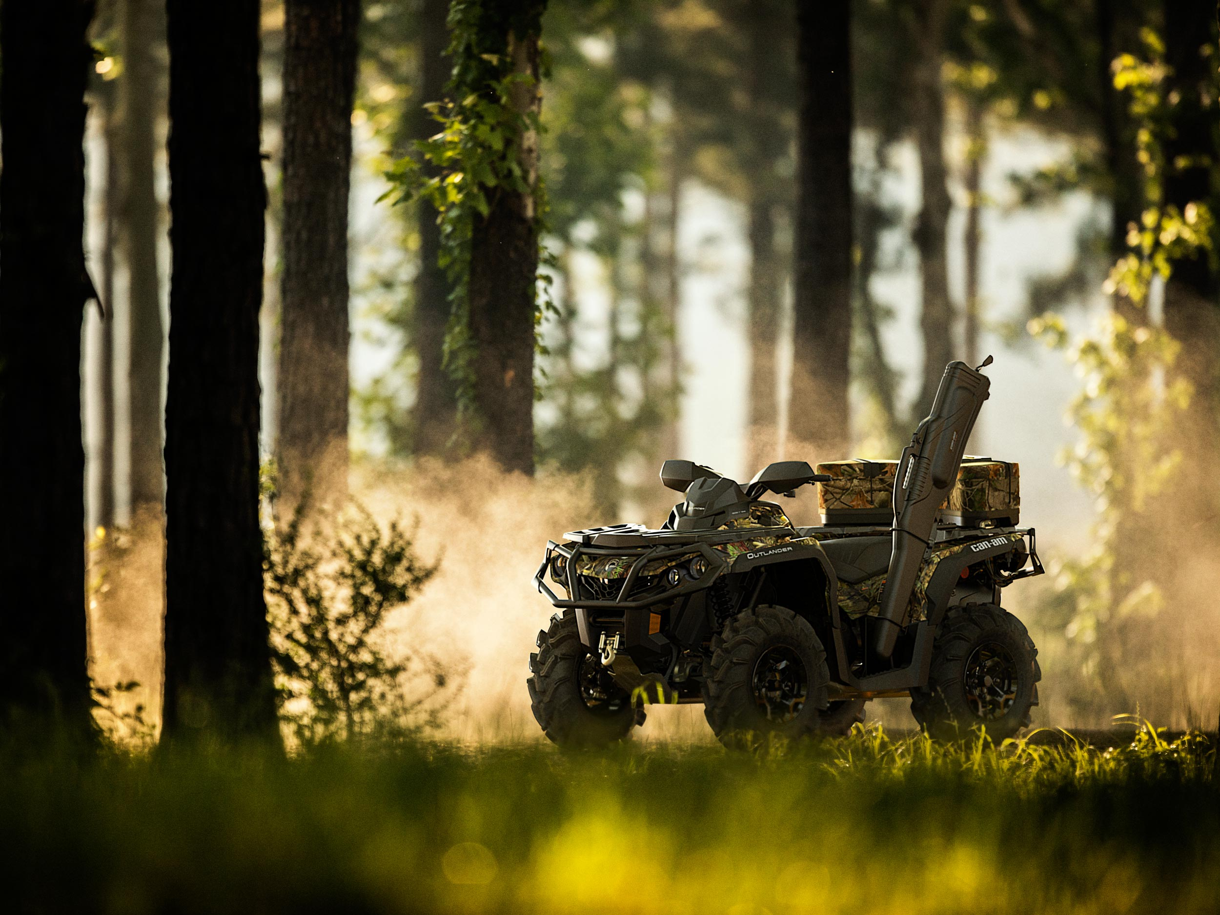 A parked Can-Am Outlander Mossy Oak Edition ATV in the forest