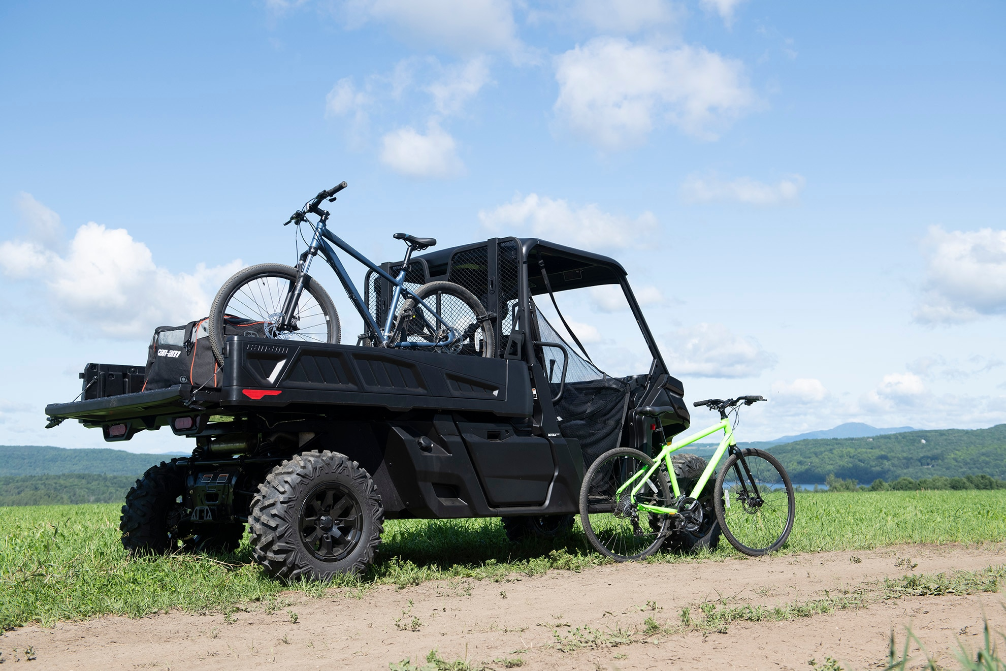 Can-Am Traxter PRO on field with bikes