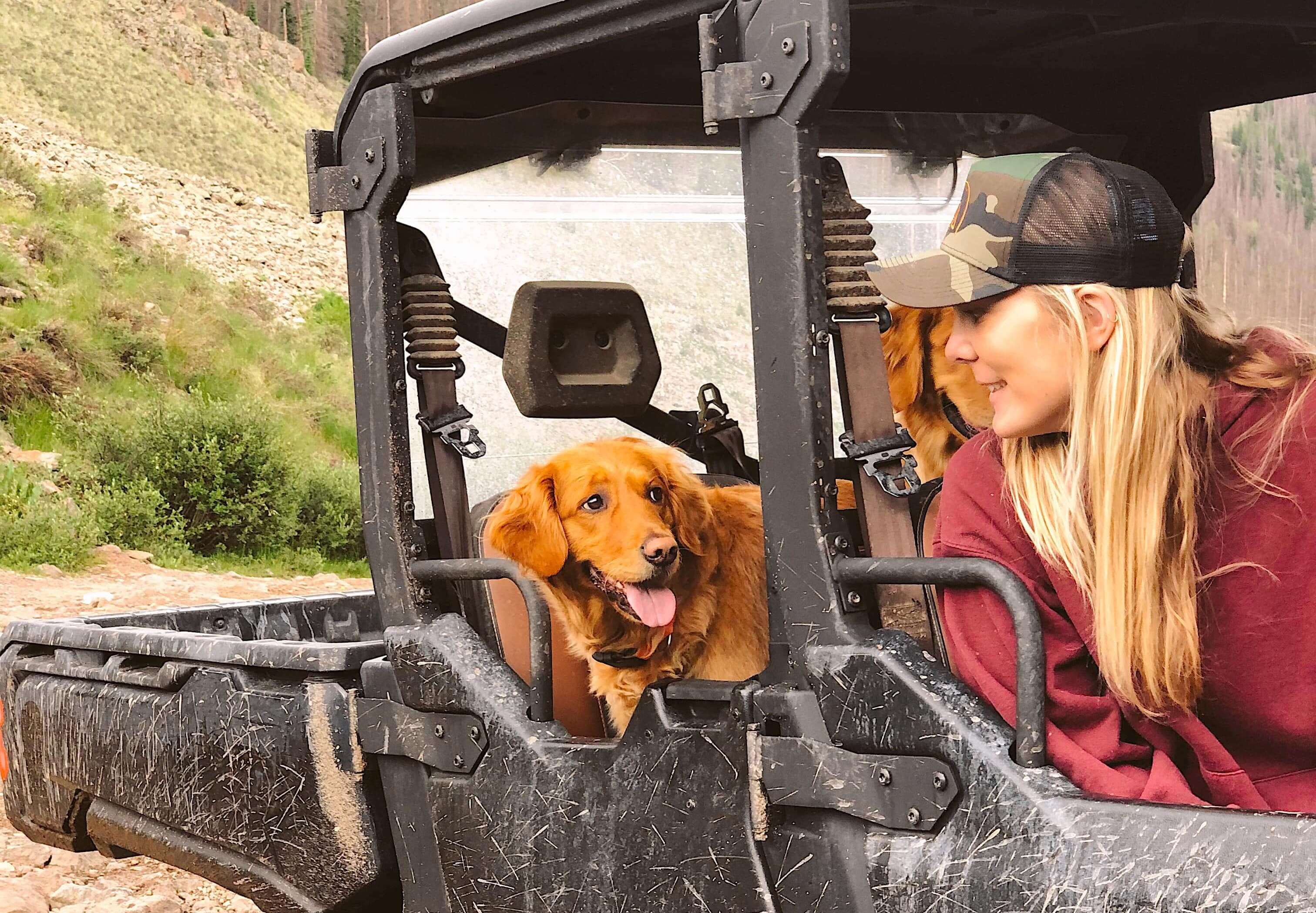 Claire Gierke and her two Red Retrievers in her Can-Am Defender Lone Star MAX SxS