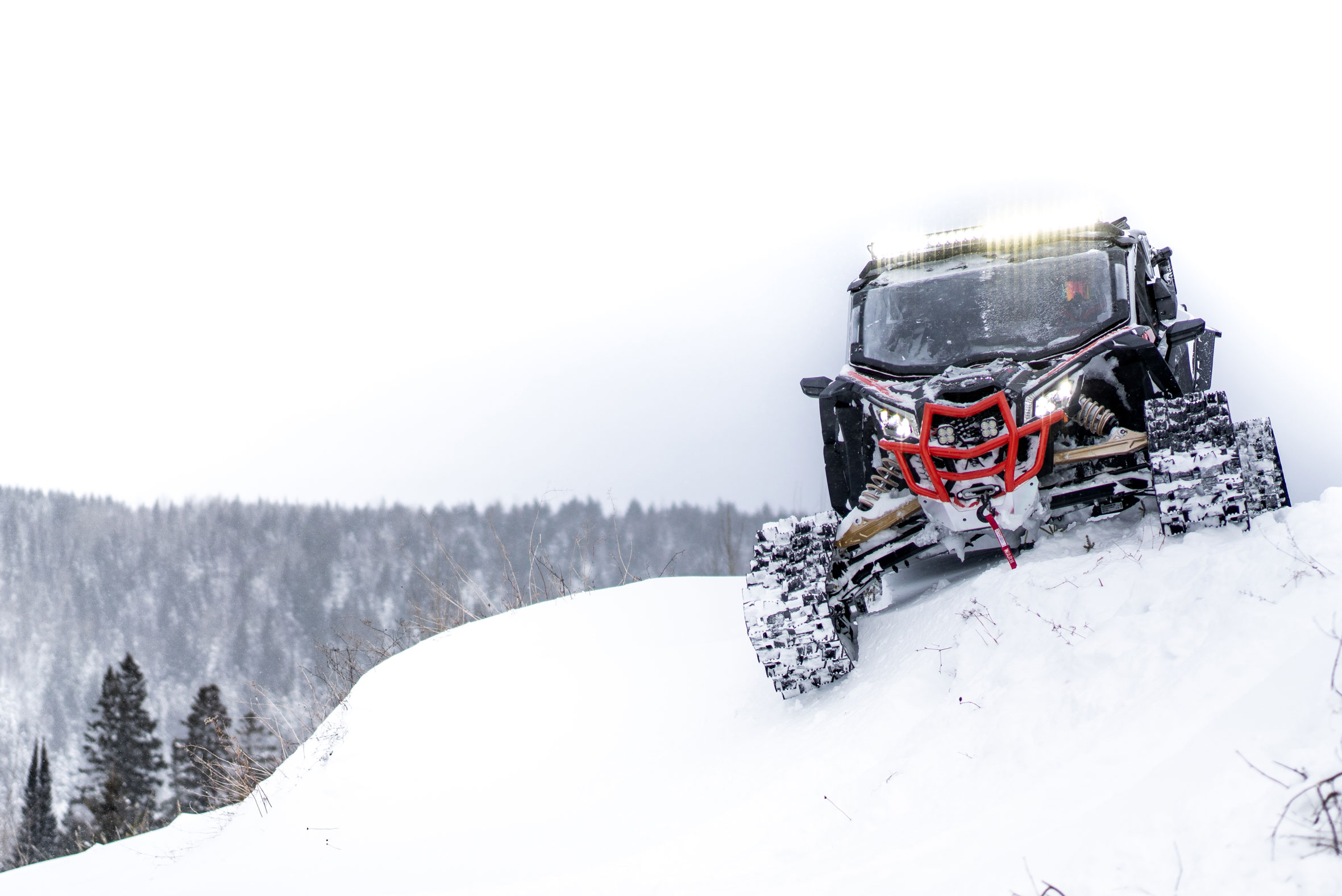 Exploring snowy mountains in a side-by-side vehicle