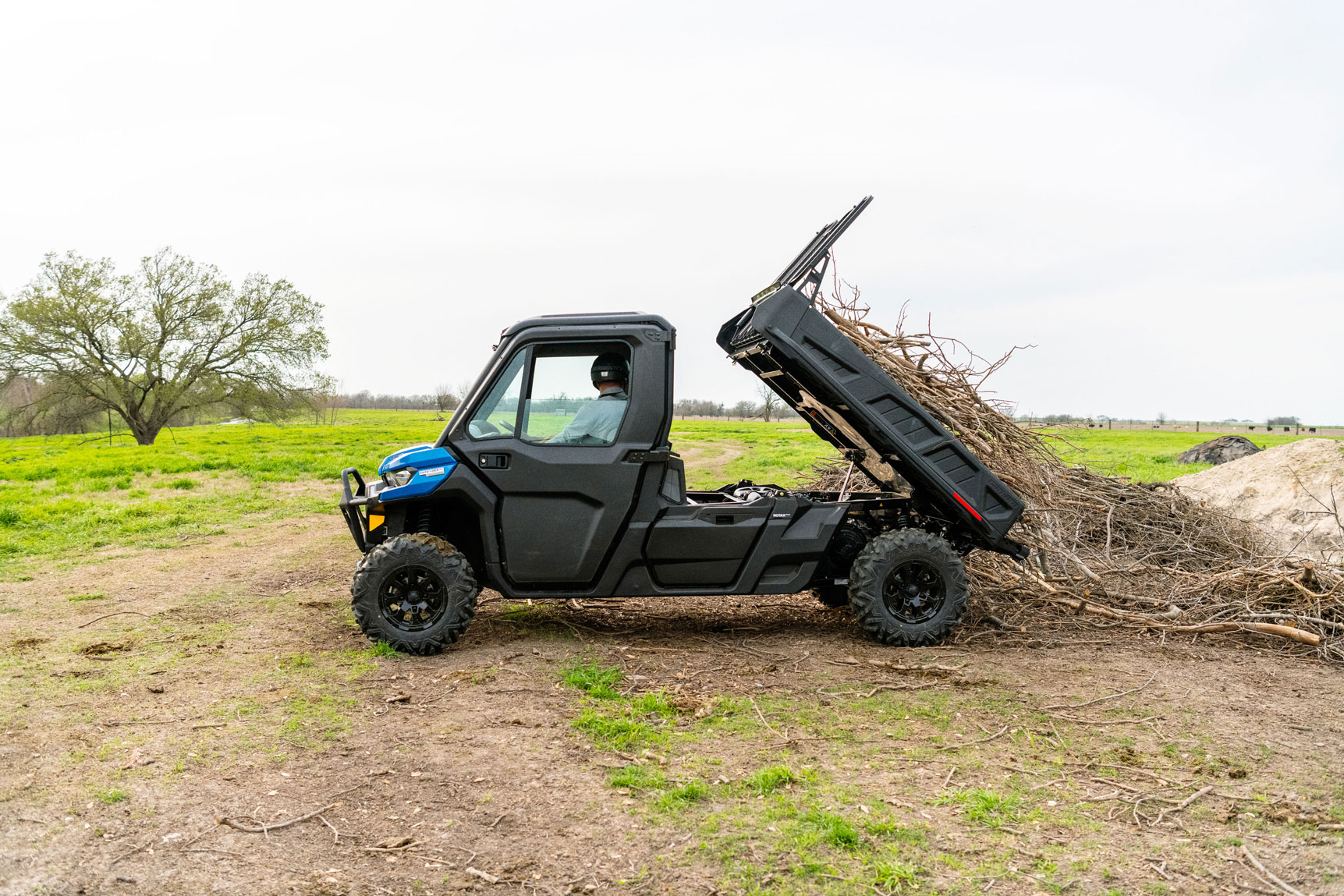 Can-Am Defender Limited side-by-side that unloads wood