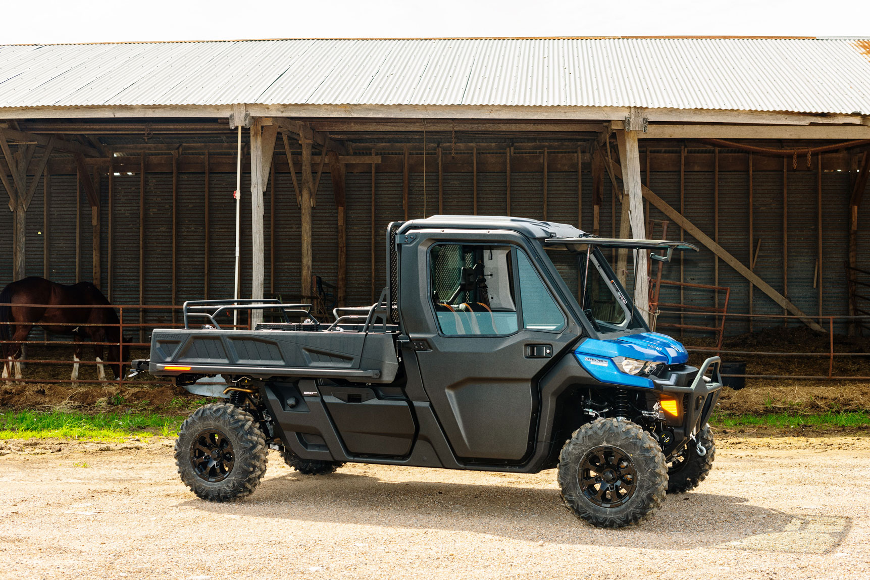 Can-Am Defender Limited side-by-side in front of a barn
