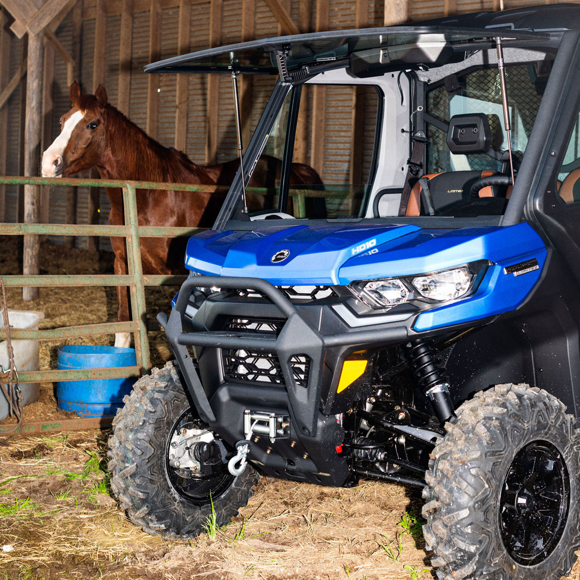 Can-Am Defender Limited H10 side-by-side in a barn