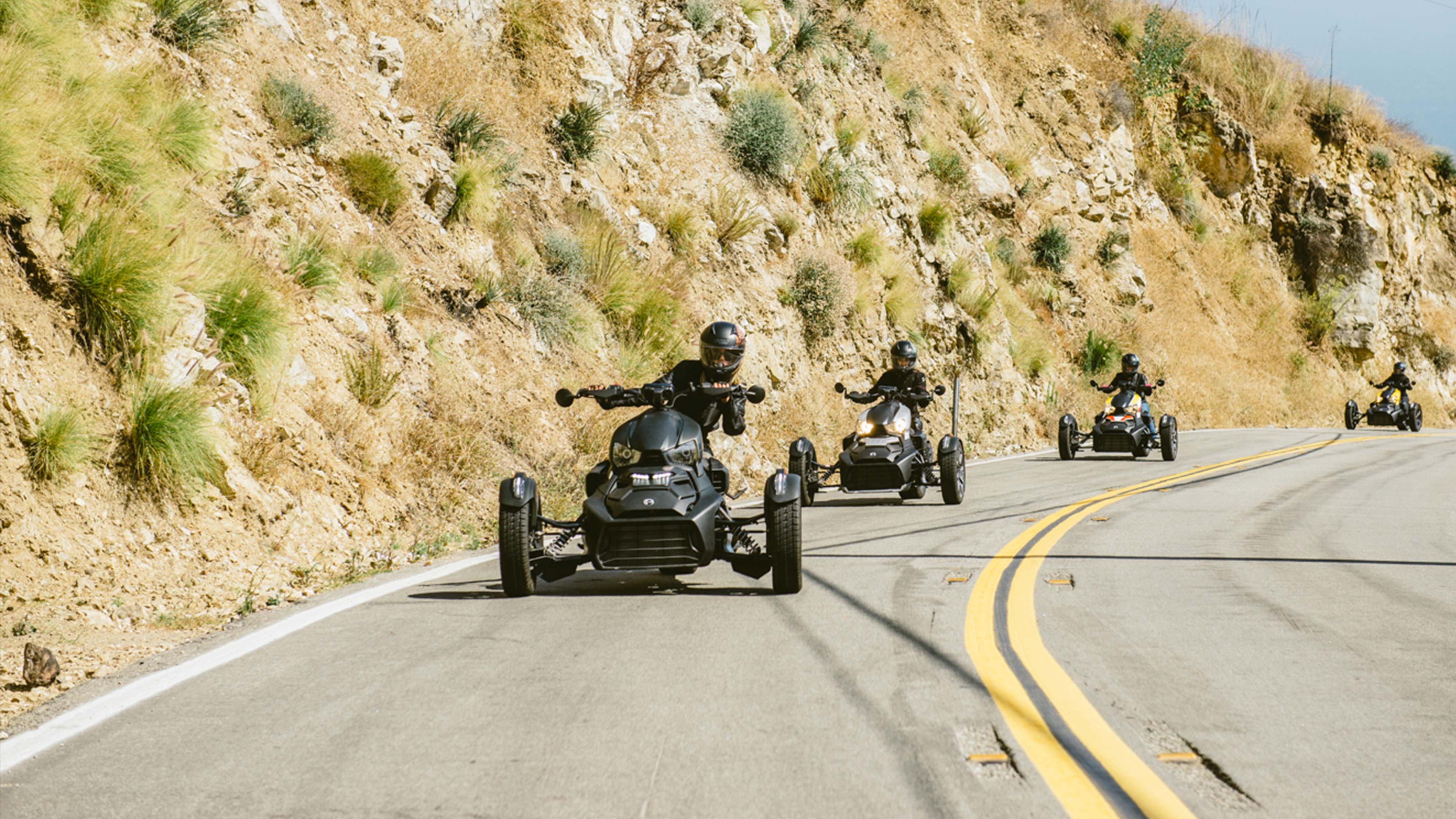 Four Can-Am Ryker riders on curvy road