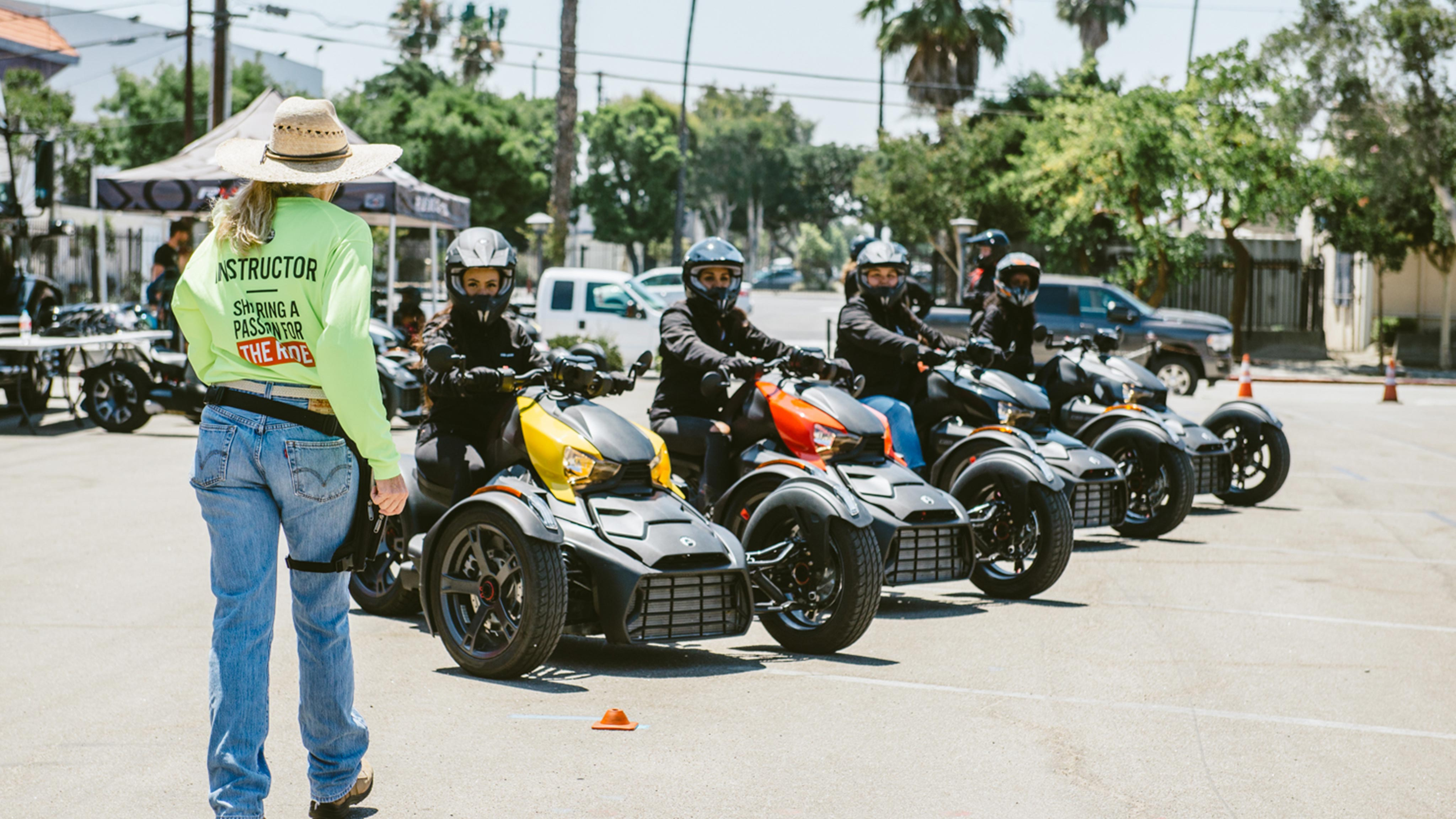Riding course instructor with three Can-Am Ryker riders