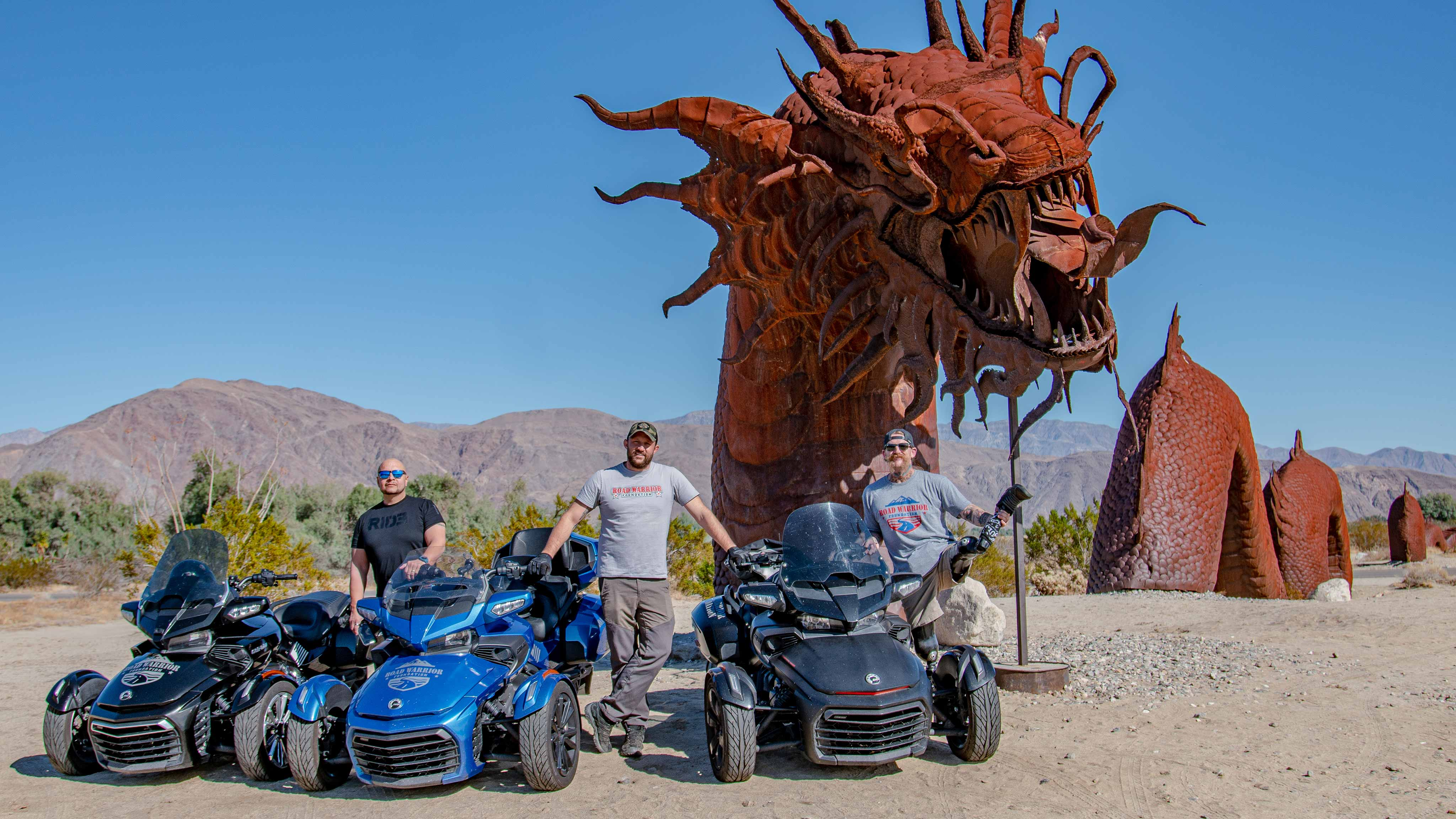 Kendell Madden with his friends standing beside their Can-Am Spyder