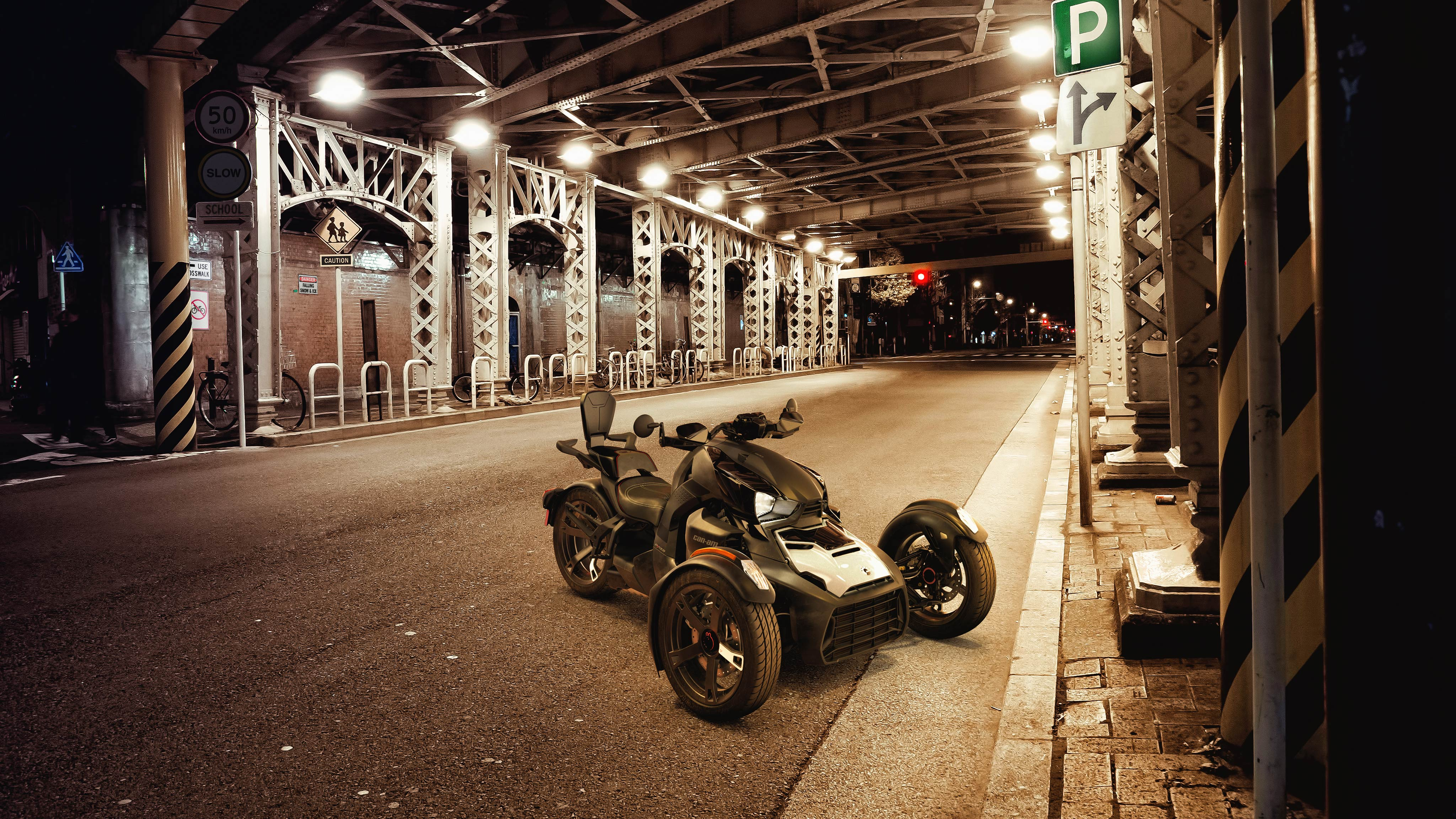 A Can-Am Ryker parked in an underground parking, with a 2-up accessory
