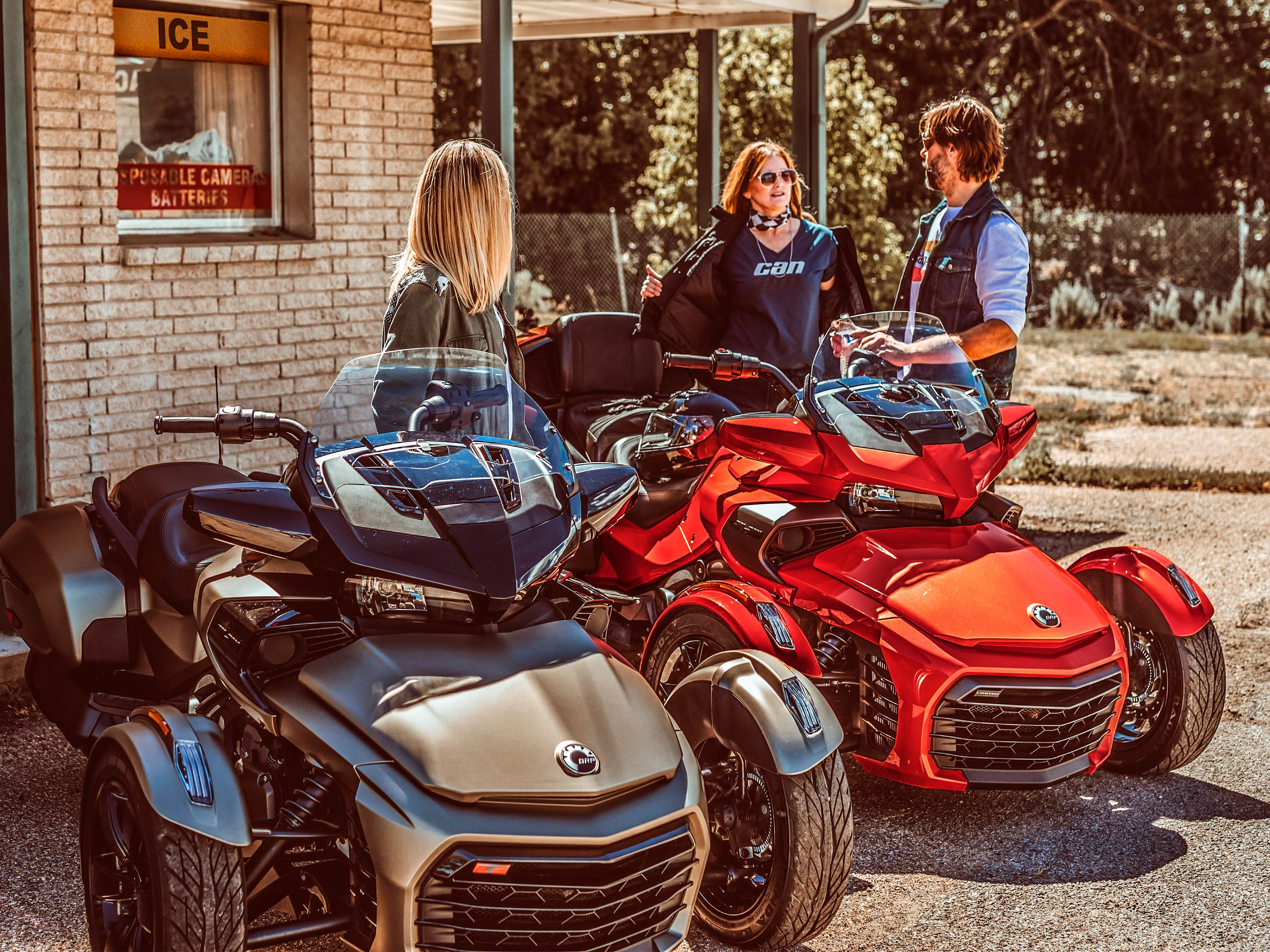 Group of riders next to Can-Am Spyder