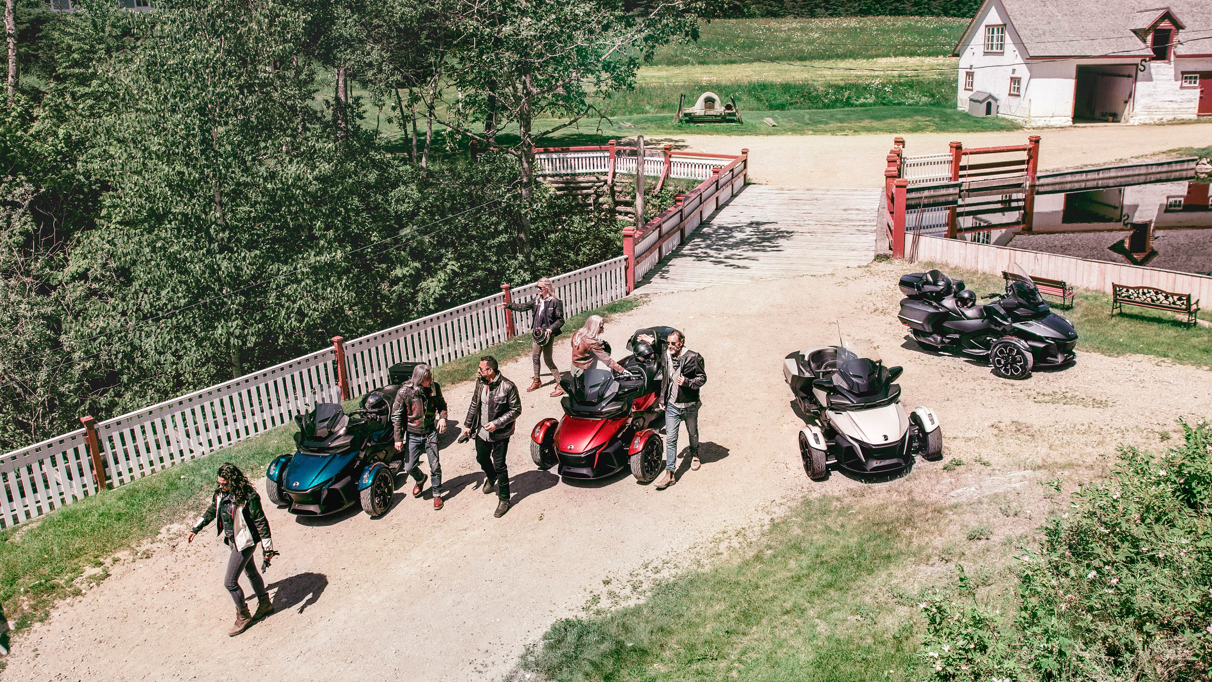 Overhead shot of friends at the farm with Can-Am Spyder RT Vehicles