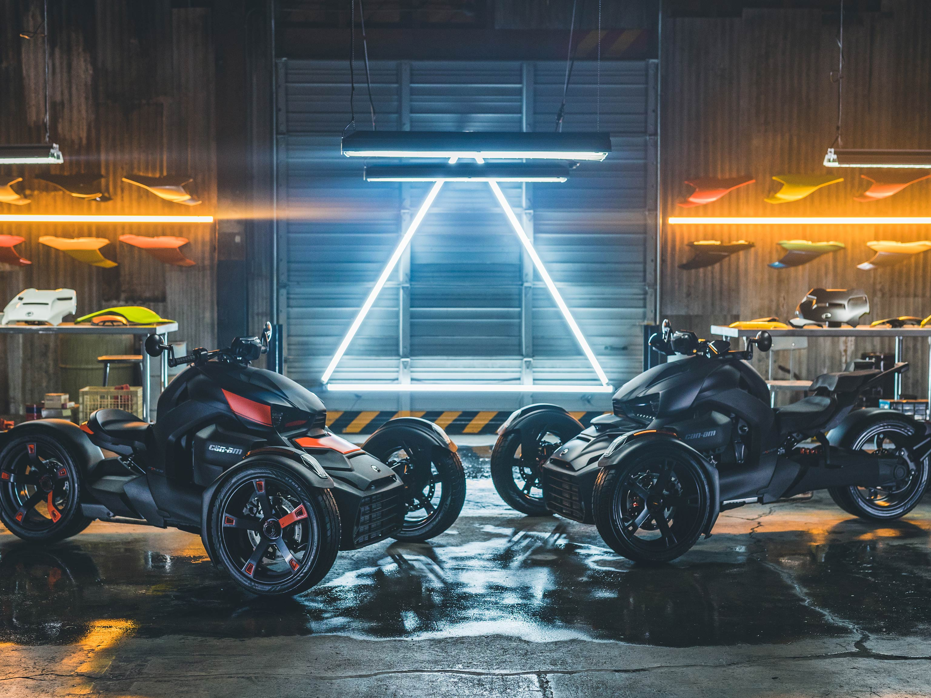 Two Can-Am Ryker facing each other in a garage
