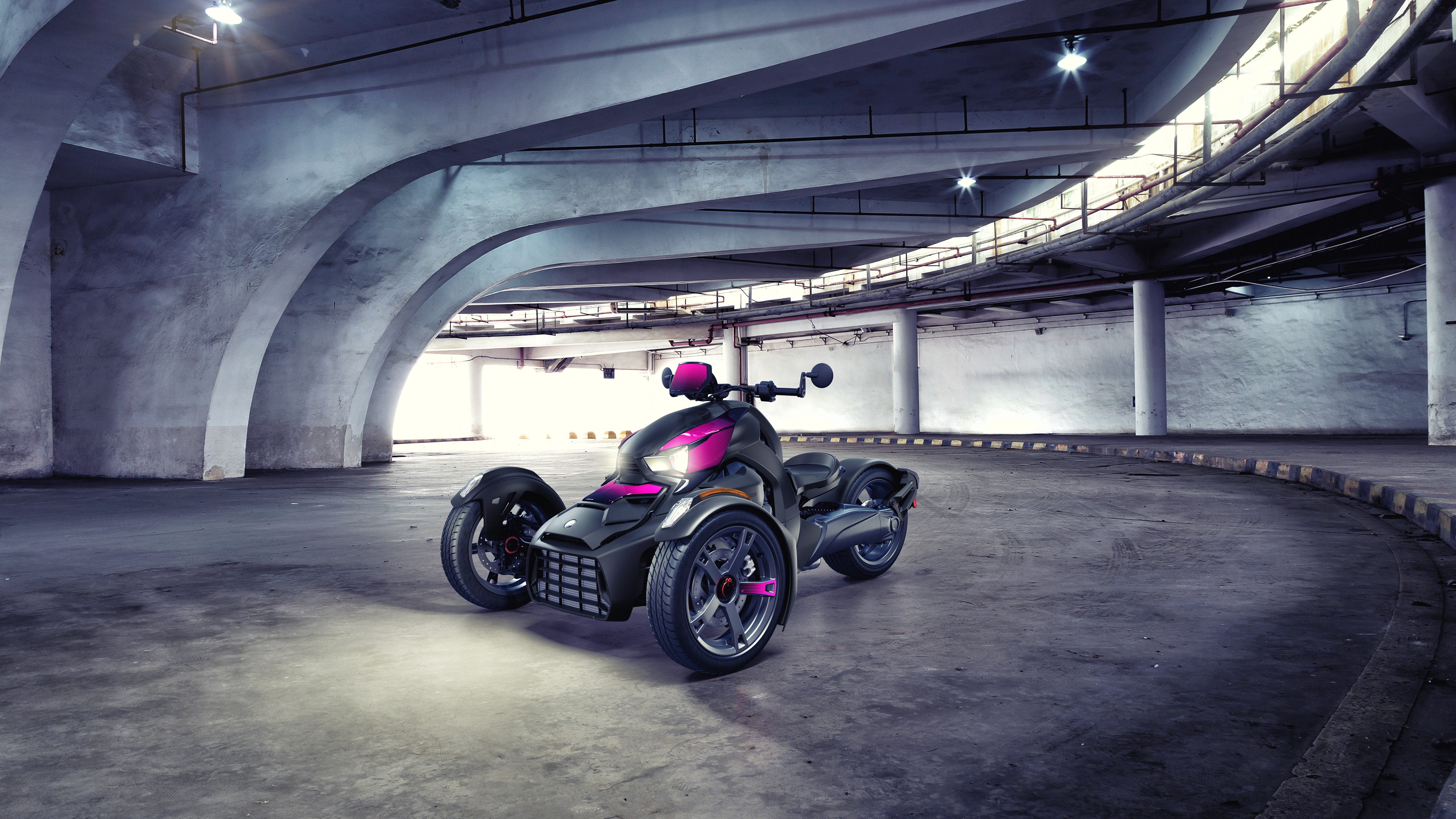 Can-Am Ryker with Pink Punk panels in a road tunnel