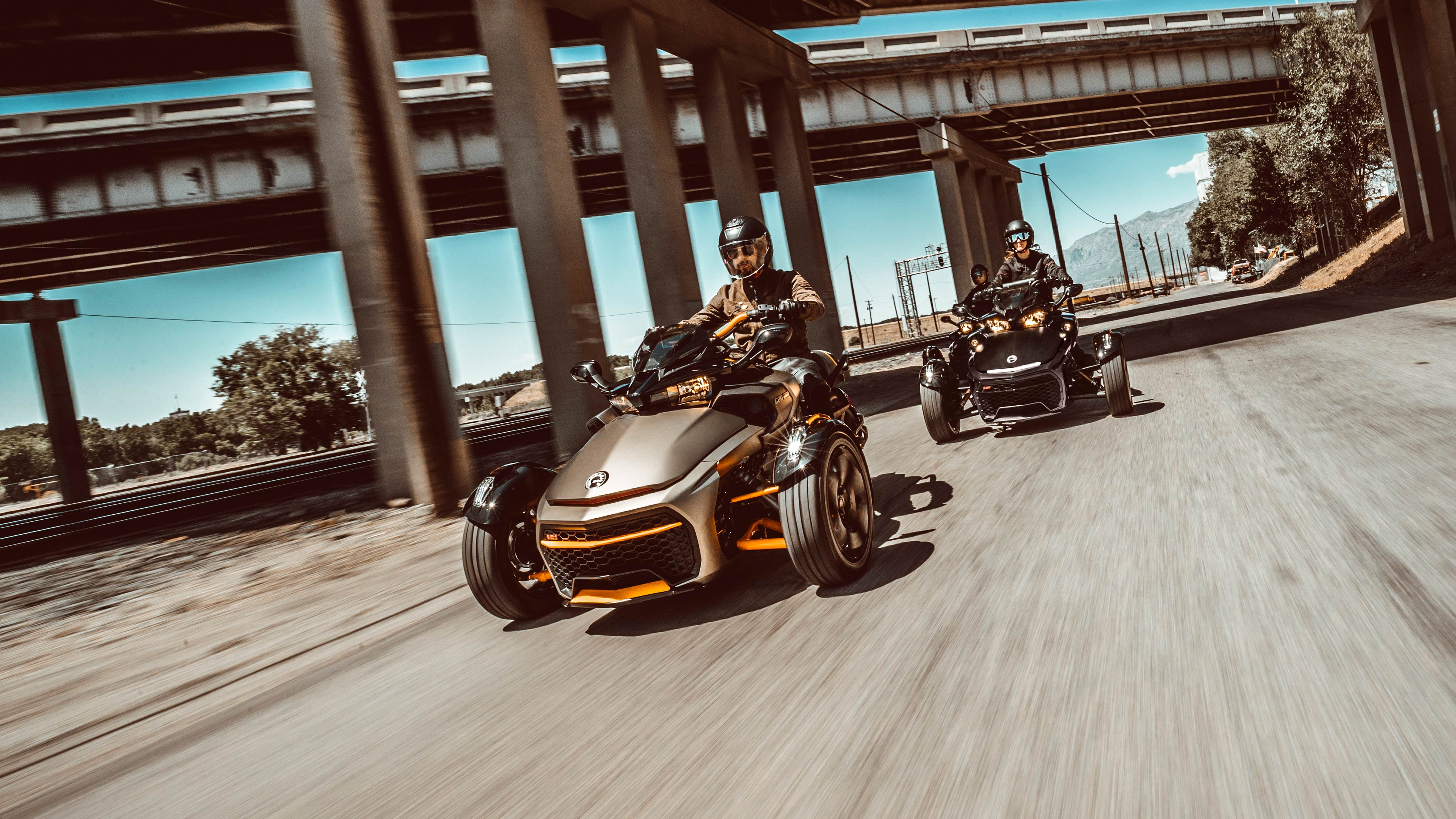 Can-Am Spyder vehicles on the open road