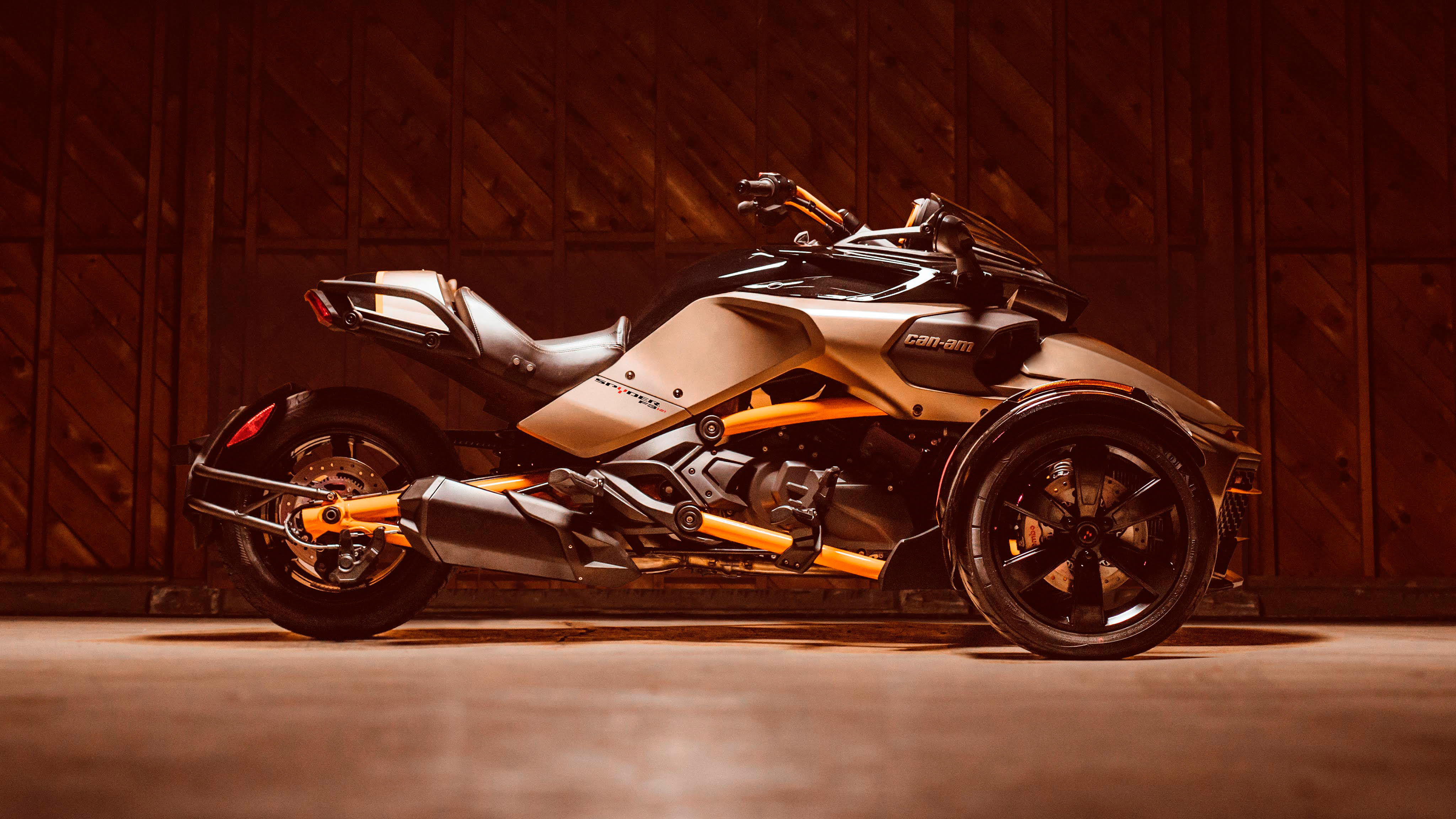 A Can-Am Spyder F3-S Special Series facing right and lit by an overhead light