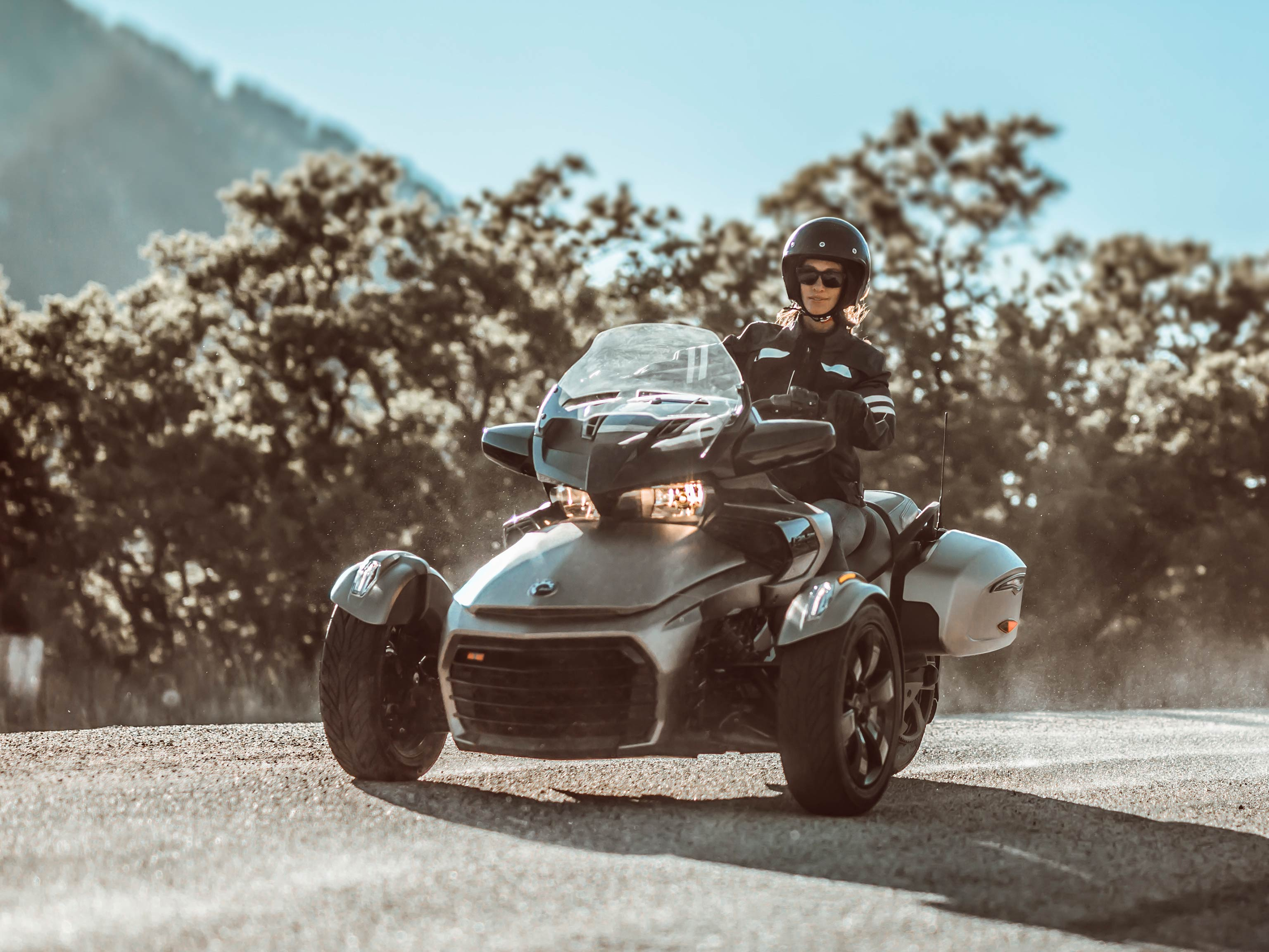 Woman riding a Can-Am Spyder vehicle