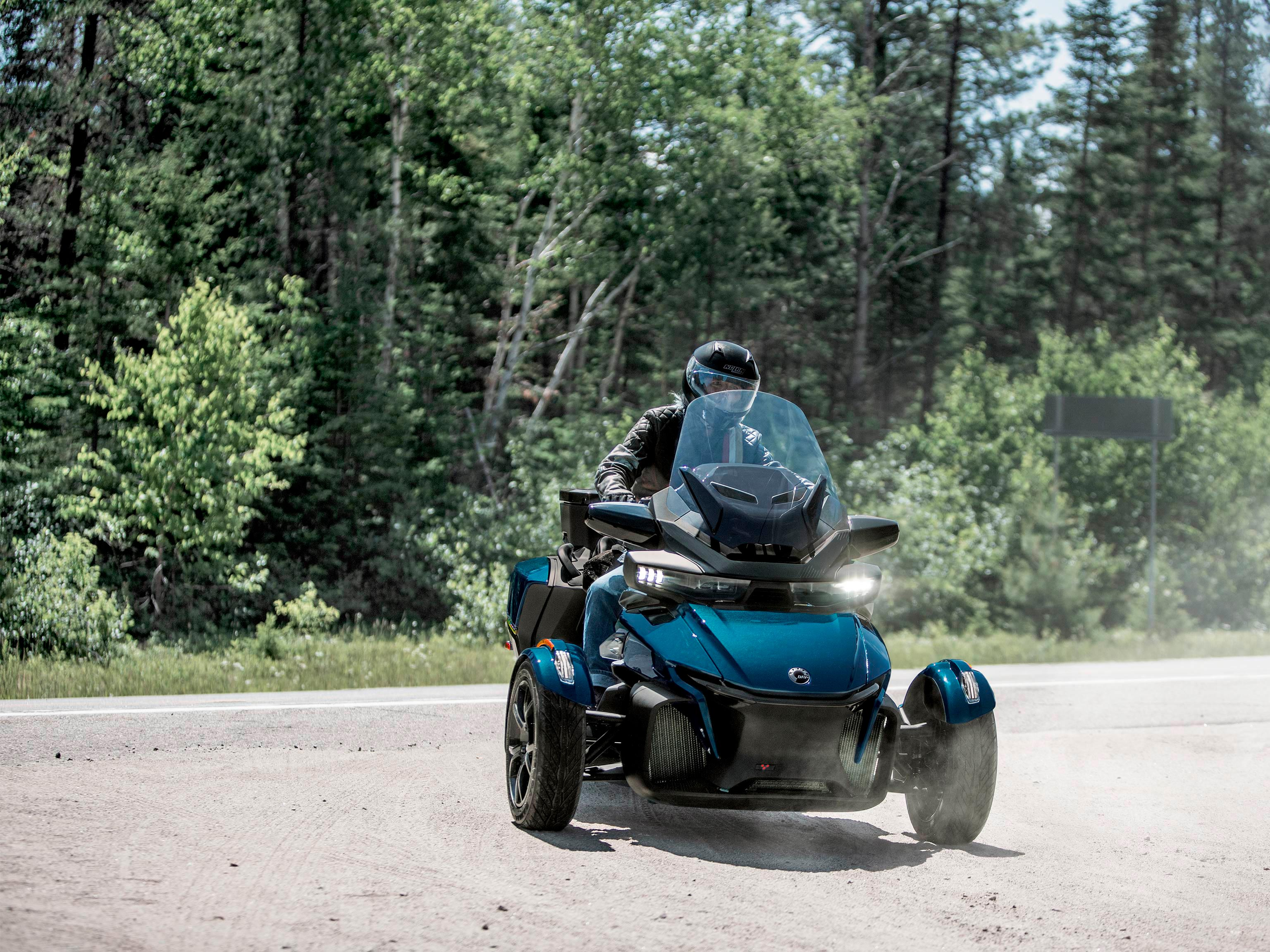 4 2020 Can-Am Spyder RT vehicles riding on open road