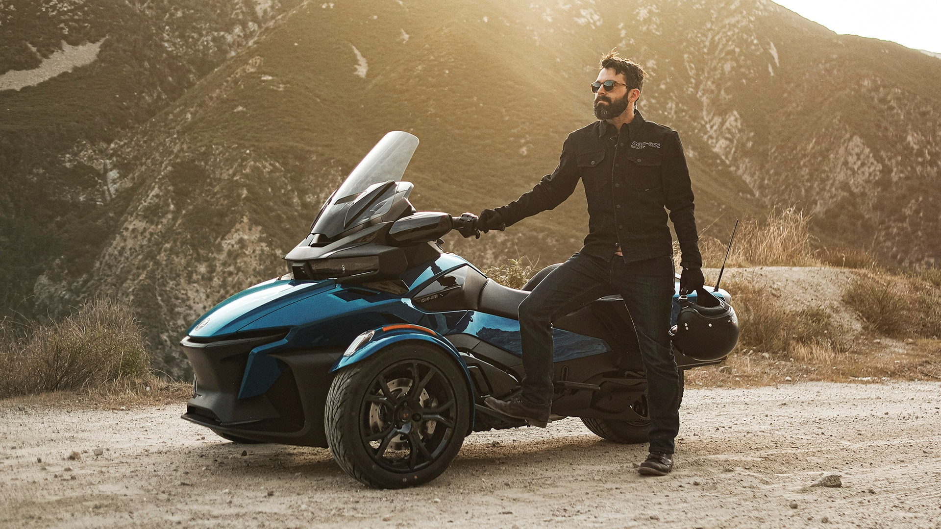 Clint Carter beside his Can-Am Spyder RT vehicle