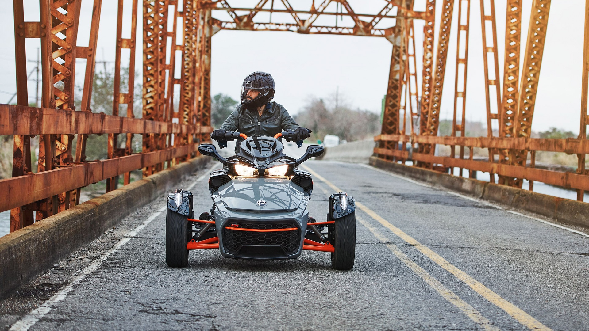 Clint driving the Spyder F3-S SS on a bridge