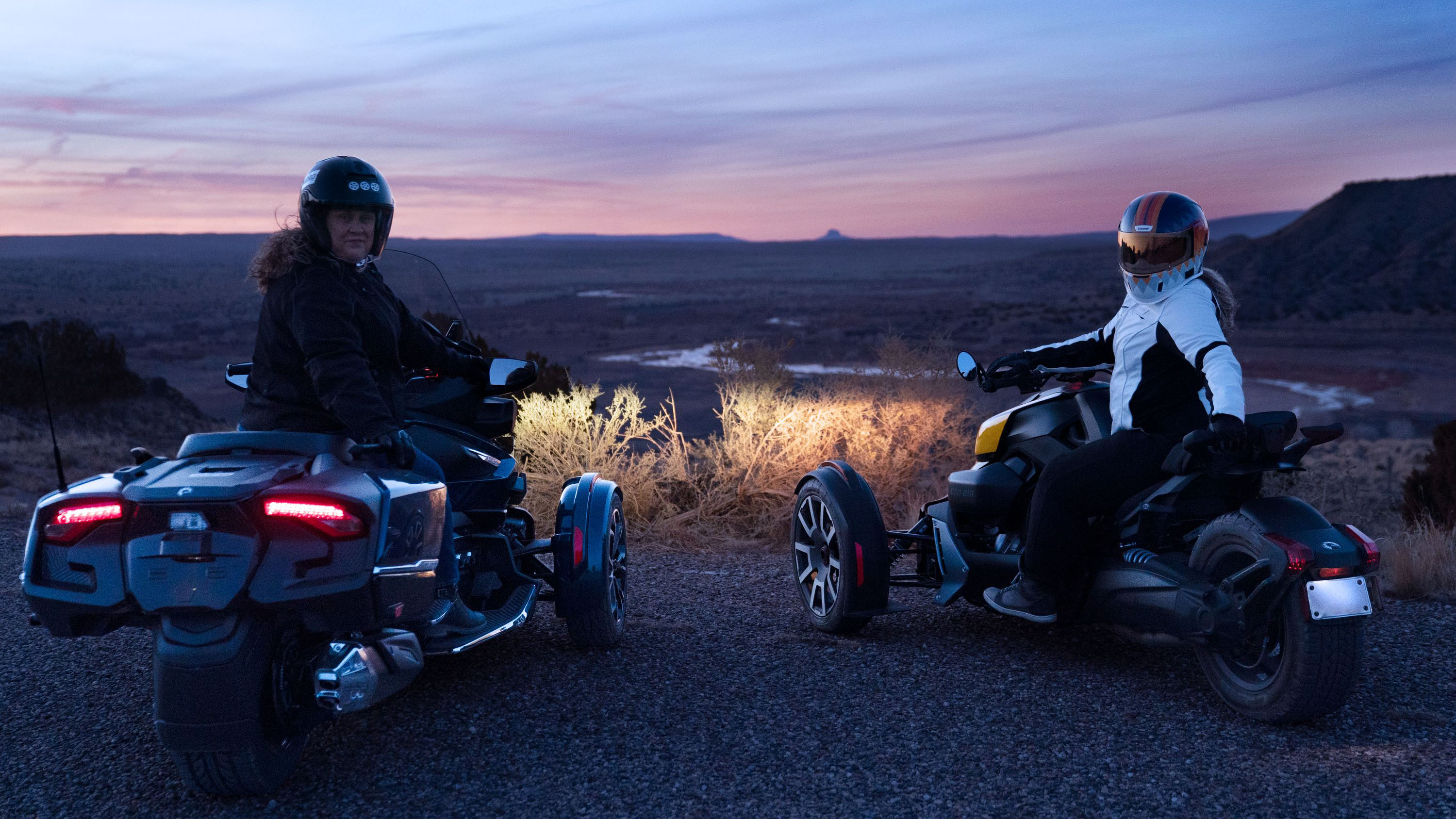 Two riders taking in scenery at dusk