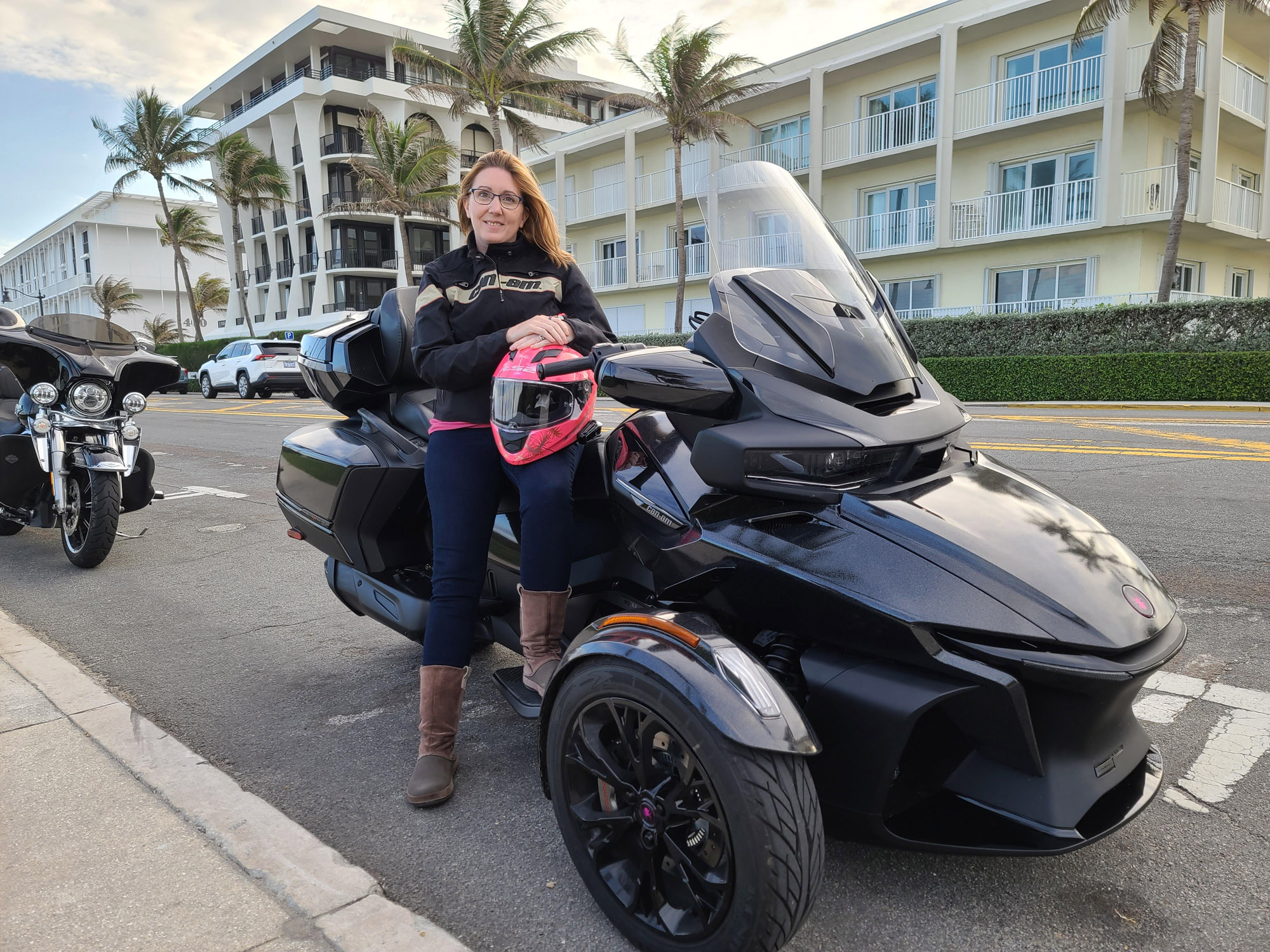 Debbie Junell sitting on her Can-Am Spyder RT vehicle